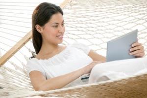 Woman Using Her Laptop in a Hammock