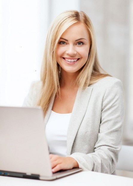 business and technology concept - businesswoman with laptop in office
